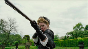 Emma Stone in The Favourite mit einem Gewehr